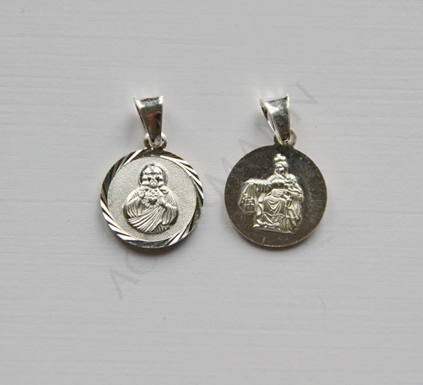 Silver medallion Christ with a burning heart